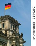 german flag on top of Berlin Reichstag - Congress - stock photo