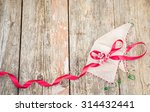 red satin ribbon with tiny pink ... | Shutterstock . vector #314432441