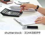 close up of female accountant... | Shutterstock . vector #314438099