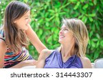 mother and daughter hugging ... | Shutterstock . vector #314443307