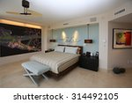 Inviting, upscale master bedroom in a high rise condominium. - stock photo