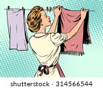 Woman Hangs Clothes After...
