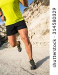 young man running in the... | Shutterstock . vector #314580329