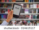 man hand holding tablet... | Shutterstock . vector #314615117