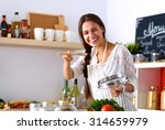 cooking woman in kitchen with... | Shutterstock . vector #314659979