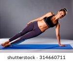 portrait of sport girl doing... | Shutterstock . vector #314660711