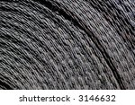 Coiled woven steel lifting straps from gold mine lift buckets - stock photo