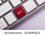 Small photo of buy button on white computer keyboard