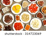 different products on saucers... | Shutterstock . vector #314723069