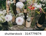 flowers and herbs in glass... | Shutterstock . vector #314779874