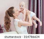 mother and baby playing and... | Shutterstock . vector #314786624