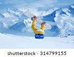 legs of a snowboarder stuck in... | Shutterstock . vector #314799155