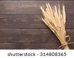 Wheat Ears On The Wooden...