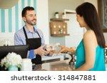 attractive young man handing... | Shutterstock . vector #314847881