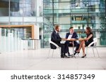 three colleagues at a meeting... | Shutterstock . vector #314857349