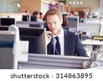 young businessman at work in a... | Shutterstock . vector #314863895