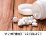 Round Pills On Wood Table...