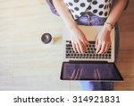 top view of laptop in girl's... | Shutterstock . vector #314921831