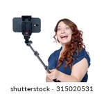 Young Woman Making Selfie With...