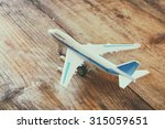 toy airplane over wooden... | Shutterstock . vector #315059651