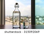 Glass Of Water With A Bottle O...