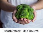 woman showing fresh green... | Shutterstock . vector #315109895