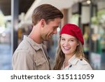 a happy couple smiling at the... | Shutterstock . vector #315111059