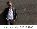 a man in his 20s wearing a... | Shutterstock . vector #315115265
