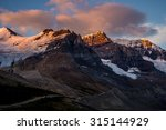 The morning sun strikes Mounts Athabasca and Andromeda in Jasper National Park, Canada.