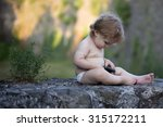 one little curious baby boy... | Shutterstock . vector #315172211