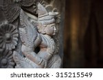 Carved Wooden Figure At Shwe...