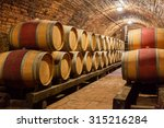 rows of oak barrels in... | Shutterstock . vector #315216284