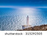 Small photo of The lighthouse of Cape of Otranto in Apulia standing on hard granite rocks is the most easterly point of Italy and marks the meeting of the Ionian Sea and the Adriatic Sea