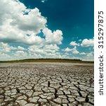 dramatic clouds over desert | Shutterstock . vector #315297875