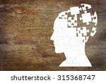 Stock photo human head as a set of puzzles on the wooden background 315368747