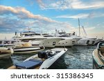 Luxury Yachts Anchored In Port...