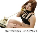 Beautiful Redhead in BDSM Gear Talking on Vintage Phone. - stock photo