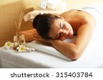 young woman on massage table in ... | Shutterstock . vector #315403784