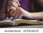Woman Praying With Her Bible O...