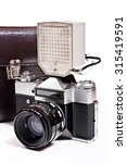 Small photo of Old range finder vintage camera with flash isolated on white. Old camera flash with a leather case isolated on a white background.