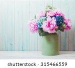 still life   flowers in can  ...   Shutterstock . vector #315466559