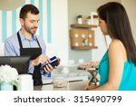 male employee in a cake shop... | Shutterstock . vector #315490799