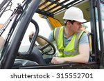 Small photo of Construction Worker Driving Digger
