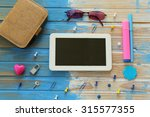 tablet computer in the middle... | Shutterstock . vector #315577355