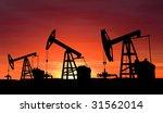 oil pump on orange sunset   Shutterstock . vector #31562014