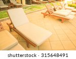 chairs on a pool deck in hotel  ... | Shutterstock . vector #315648491
