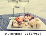 tasty finger food on a wooden... | Shutterstock . vector #315679619