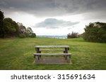 Picnic Table In A Grassy...