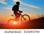 Silhouette Of A Bike On Sky...