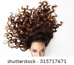 curly hair and part of woman' s ... | Shutterstock . vector #315717671